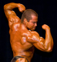 Lee Hayward Twisting Back Double Bicep Pose